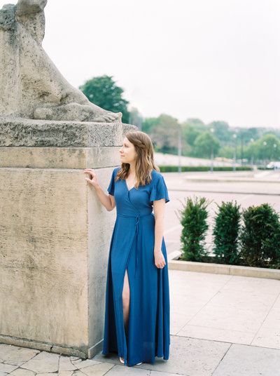 Portrait of woman in blue dress with eiffel tower in Paris