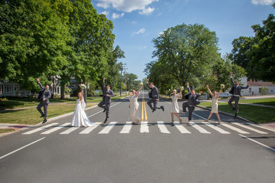 Wedding party crossing crosswalk