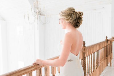 bride looking out over the white sparrow barn