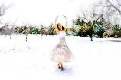 Dancer in snow with bubbles