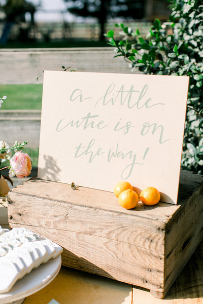 wedding sign sitting on table with oranges