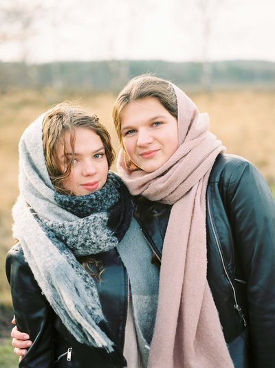 Image of two sisters on the heath in Holland during a winter family shoot by Rosie Reports Lifestyle Film Photogaphy