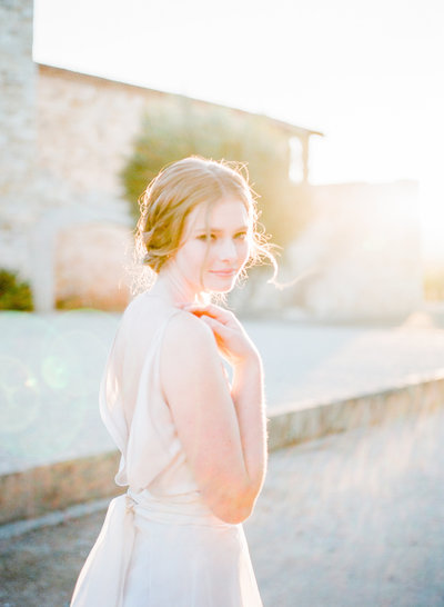 Wedding dress from  LOHO Bride, sunset bridal portrait at  Sunstone Winery Villa, Santa Ynez California - fine art film photography by Evonne and Darren