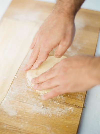 Hands kneading dough for fresh pasta, film photography for makers, artisans and artists