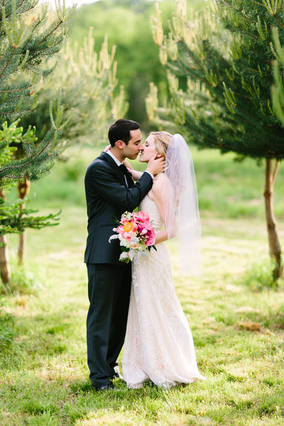 Bride and groom kissing at Blooming Hill Farm Wedding
