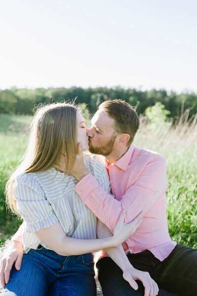 couple kissing in field at cuyahoga valley national park