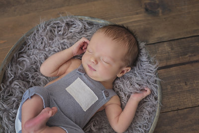 Newborn boy in knitted outfit