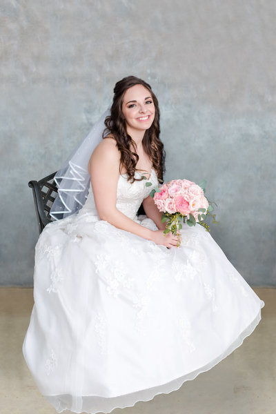 Bridal portrait with pink peony bouquet