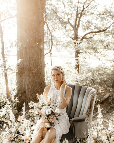 bride sitting with a bouquet