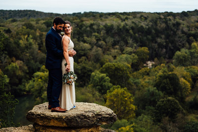 Elopement with couple on edge of cliff at Narrows of the Harpeth