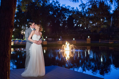 Bride and Groom with fire in lake at Lake Oak Meadows
