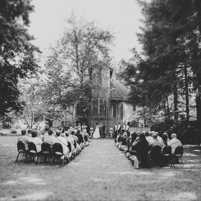 black and white wedding ceremony photo at McMenamins  Cornelius Pass Roadhouse  barn | Susie Moreno Photography