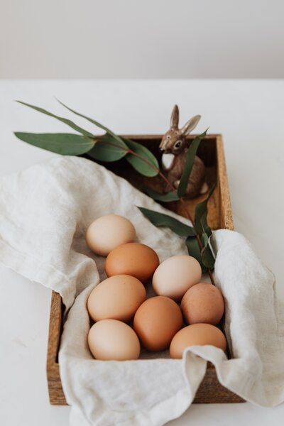 brown-eggs-and-ceramic-bunny-on-a-wooden-tray-4226900