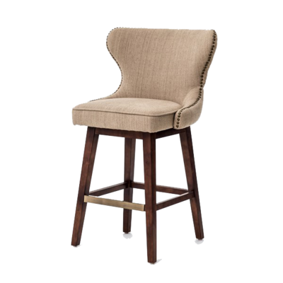 Tan dining stool with studded fabric, backrest, and wood legs from Hockman Interiors