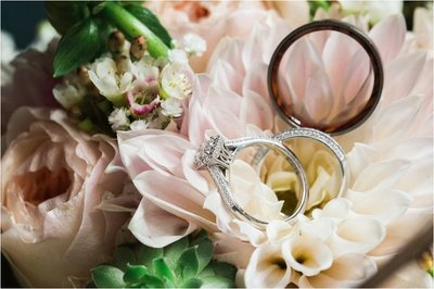 CB Photography a la carte | Wedding rings on top of flowers