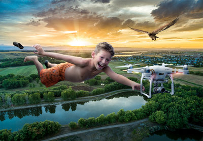 Photoshop composite of boy flying with drone