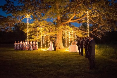 Farrar Hill Farms Manchester Wedding at night lit by bright strings of lights hanging from large tree