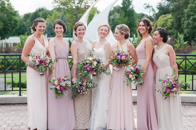 Summer outdoor Franklin Park Conservatory Wedding with pink blush bridesmaids dresses and beautiful wedding bouquets .