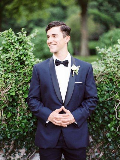 smiling-groom-navy-tuxedo