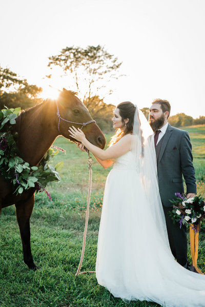Bride in a wedding dress and her groom enjoy an evening ranch wedding