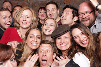 Large group of corporate event group of attendees takes a fun photo booth photo