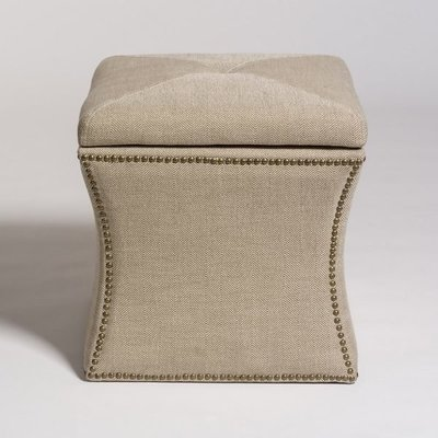 Tan ottoman with studded embellishments and cinched in sides from Hockman Interiors