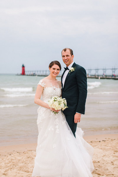 bride and groom on South Haven beach