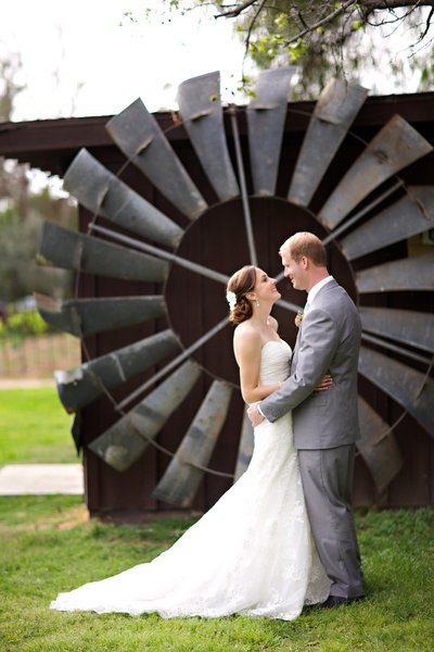 Bride and Groom in front of windmill at Bernardo Winery