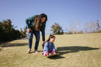San Antonio Photographer Irene Castillo playing with her daughter at the Botanical Garden for instagram picture @irenesplanit