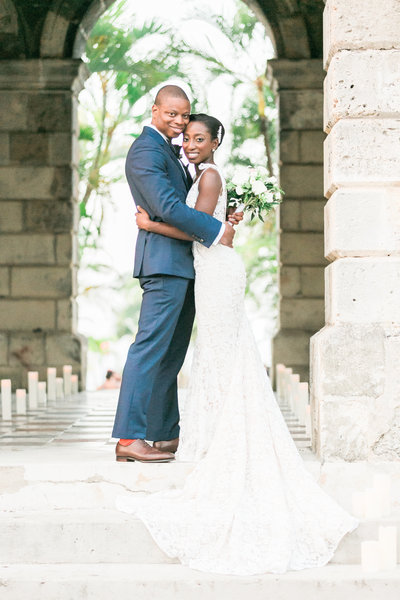 Outdoor ceremony by lily pond at Historic Codrington College, Barbados - fine art destination photographers, Evonne & Darren, as seen in Martha Stewart Weddings
