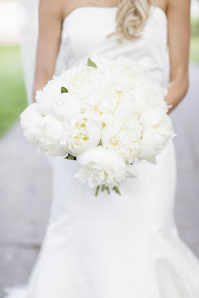 White Peonies Wedding bouquet held by bride