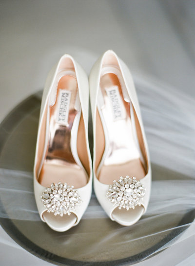brides shoes on table with veil