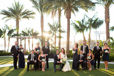 Wedding party photo with palm trees at Hilton Bayfront