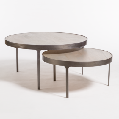 Circular nesting table with metal legs from Hockman Interiors