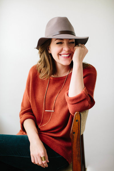 personal branding image laughing female hat orange sweater smiling headshot lincoln nebraska