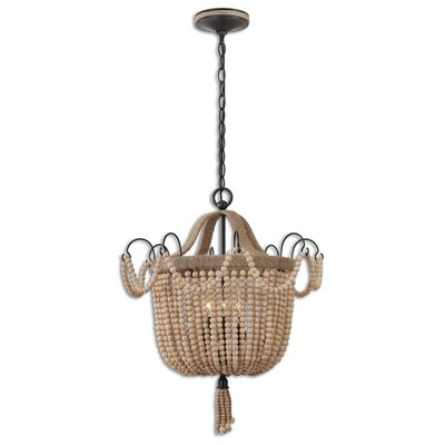 Hanging Light fixture made from wooden beads and tassel detail at Hockman Interiors