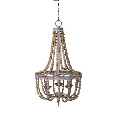 Hockman Interiors chandelier with hanging wooden beads and circular base