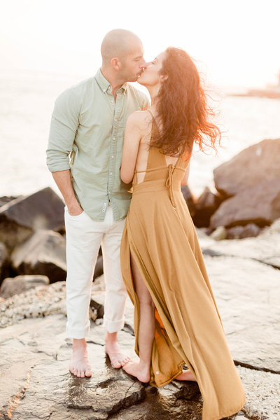 beach engagement session on the jetti at sunset