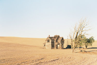 Old farm house in a barren field