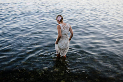 Bride Wading in water