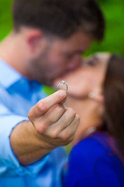 engagement session with groom holding the ring