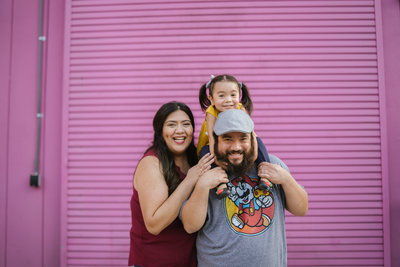 San Antonio Photographers Irene Castillo and David Castillo with their daughter posing for instagram photo