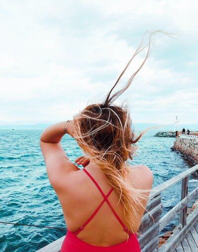 photography-of-woman-near-ocean-1368523
