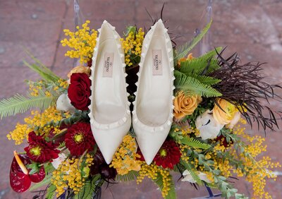 creme-wedding-shoes-and-flowers-burgundy-yellow