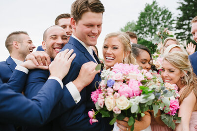 akron country club wedding couple celebrating with bridal party