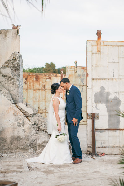 Sacramento Old Sugar Mill bride and groom snuggling portrait