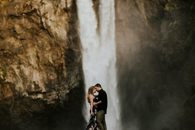 Snoqualmie Falls Seattle WA Engagement Couple Kissing