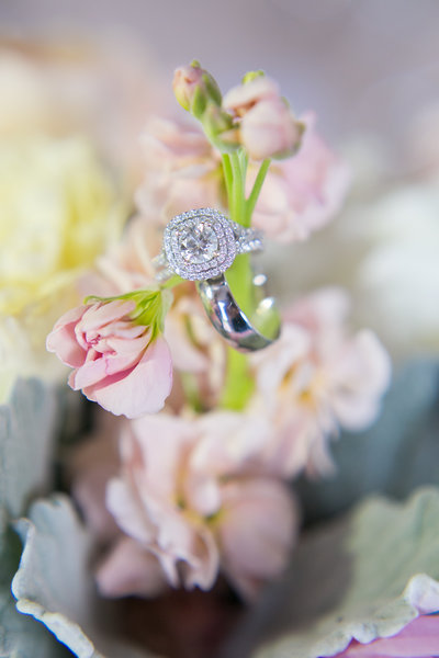 wedding rings on flowers