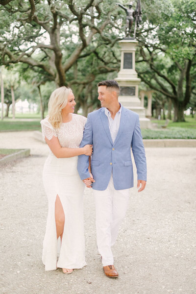 couple walking through garden park in charleston south carolina anniversary session by costola photography