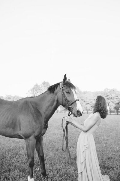 black and white senior portrait at horse farm